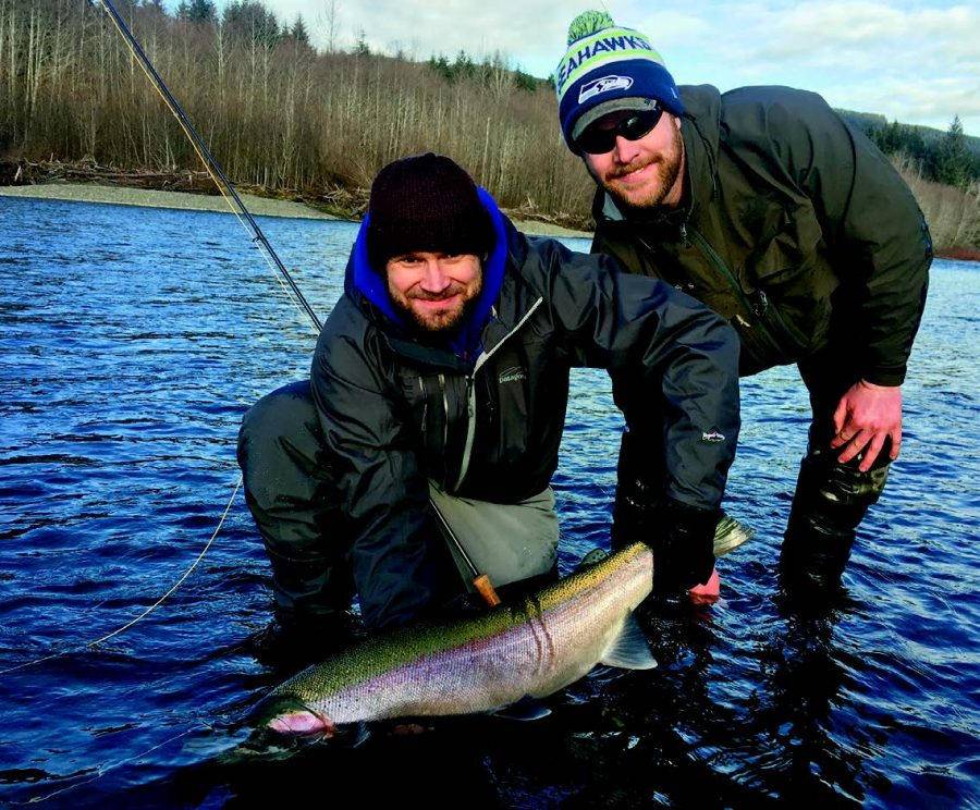 John Umek holding his Steelhead catch on the Hoh River in Washington with his Guide Greg Springer
