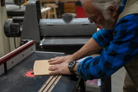 Roundhouse patron Dave Richardson uses a router to shape a cutting board.