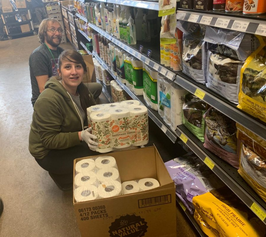 New Moon employees Kyle Reed and Rose McMillen restocking toilet paper. Photo: Elizabeth White