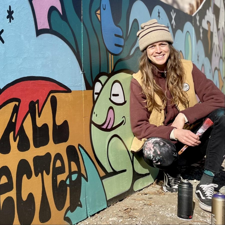 Pro snowboarder and artist Hannah Eddy poses with some of her work. Eddy says she has become fascinated with murals.