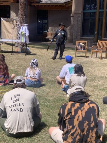 Event attendees listen during a Washoe land acknowledgement, at Sierra Nevada Universitys Earth Day celebration on April 22.