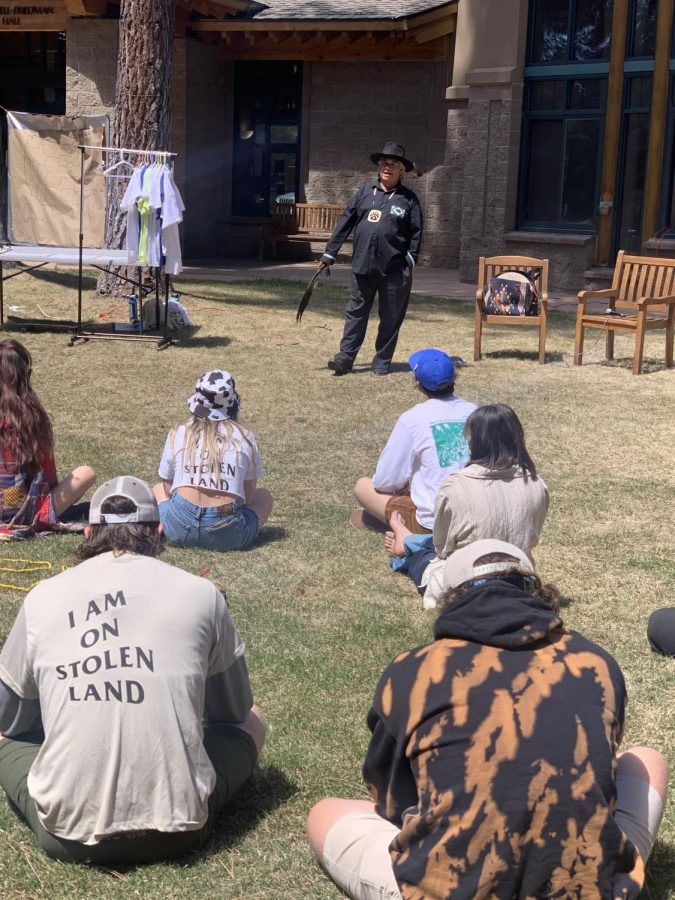 Event+attendees+listen+during+a+Washoe+land+acknowledgement%2C+at+Sierra+Nevada+Universitys+Earth+Day+celebration+on+April+22.+